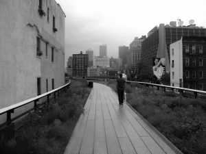 People walking in Highline park on a rainy day