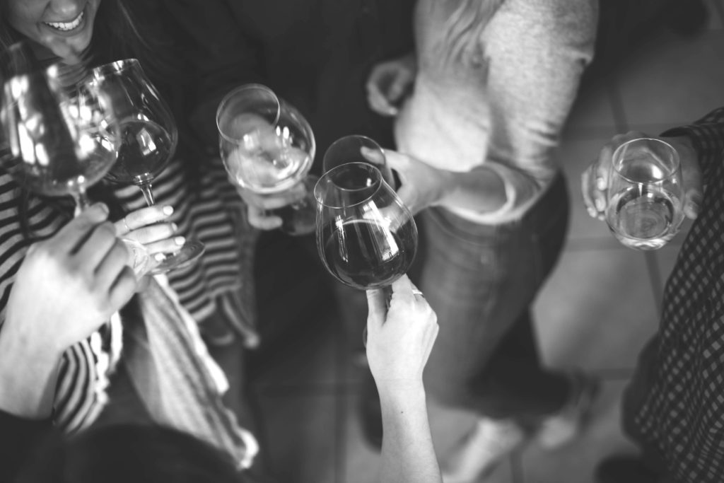 Young professionals holding wine glasses