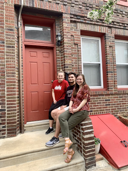 Temple Law students on their front stoop.