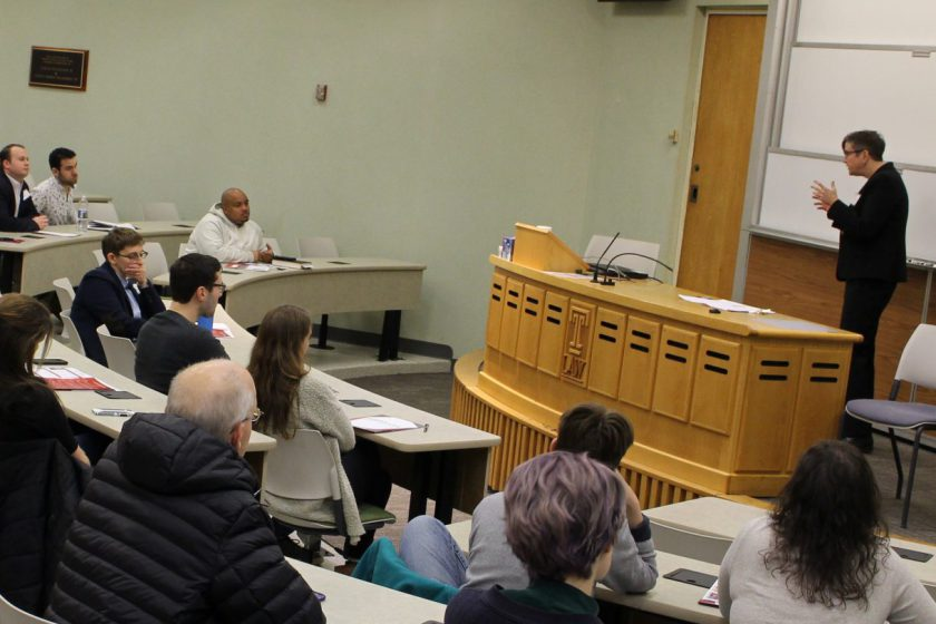 Prof. Carpenter speaks to a lecture hall with seated students