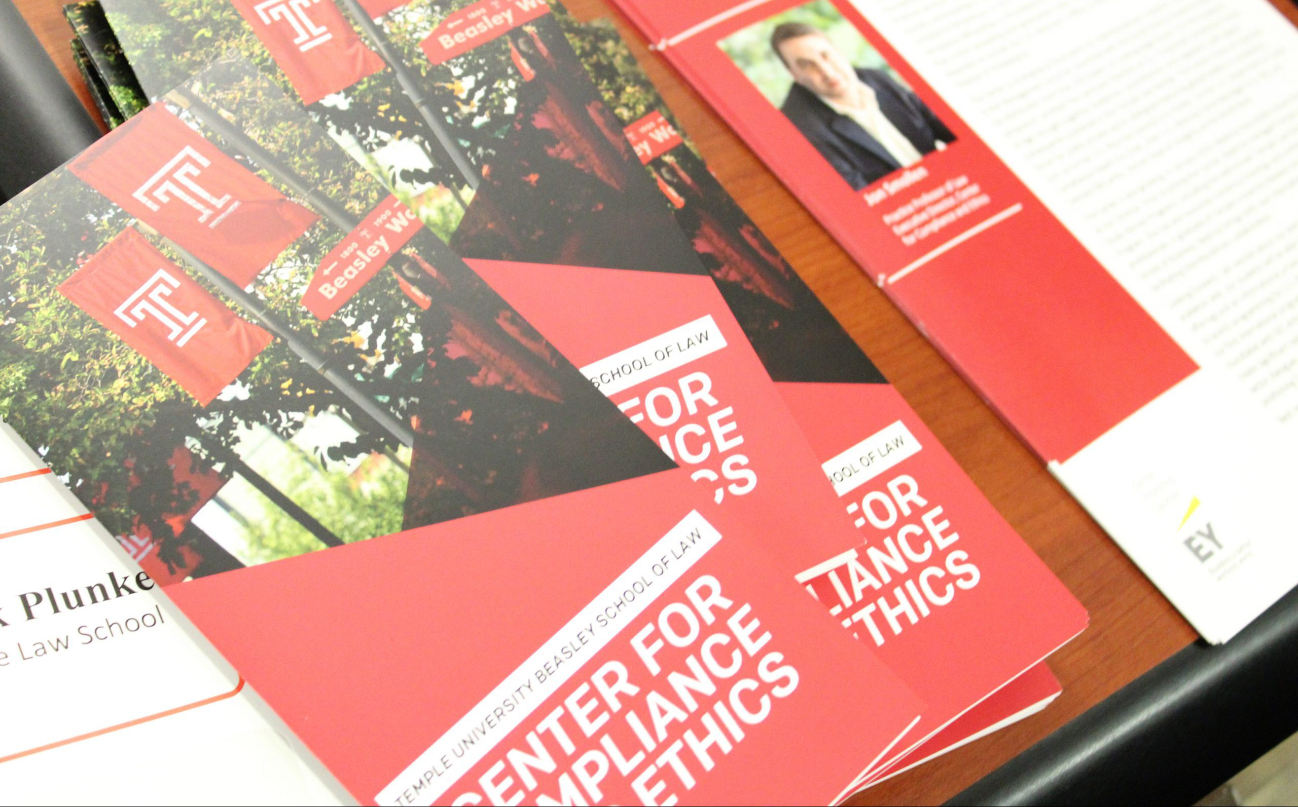 Center of Compliance and Ethics brochures on a deck